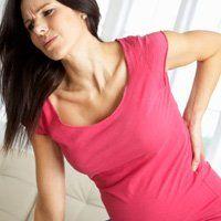 Болі в попереку при вагітності на ранніх і пізніх термінах